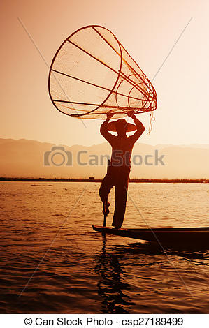 Stock Photographs of Local Fisherman Placing a Fish Trap in Inle.