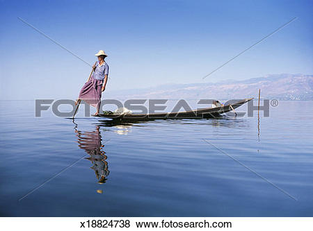 Pictures of Man Rowing a Fishing Boat, Inle Lake, Burma x18824738.