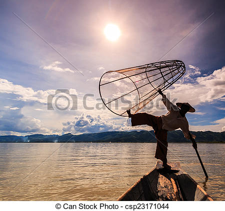 Stock Photo of Myanmar Inle lake fisherman on boat catching fish.