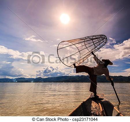Stock Photo of Myanmar Inle lake fisherman on boat catching fish.