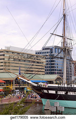 Stock Image of Tall ship moored at a harbor, USS Constellation.