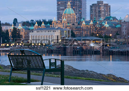 Stock Photography of Park bench in foreground looks over inner.
