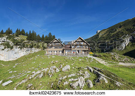 "Stock Image of ""The Bollenwees mountain inn above lake Faehlensee."