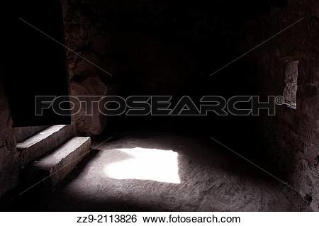 Stock Images of Dark room of a castle with light input through the.