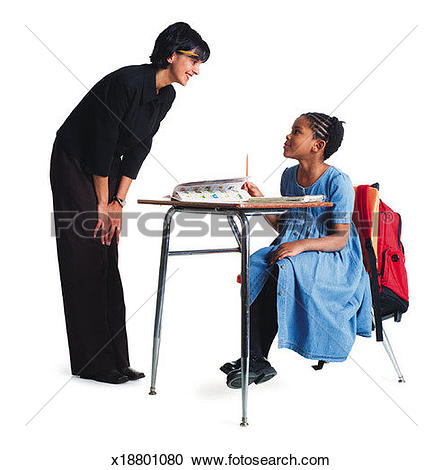 Stock Photography of an ethnic female school teacher instructs a.