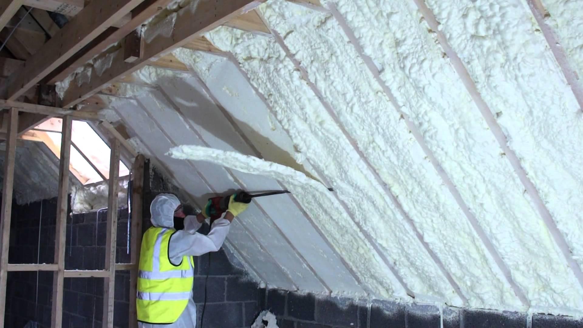 spray foam of attic using fusion sprayfoam insulation being cut.