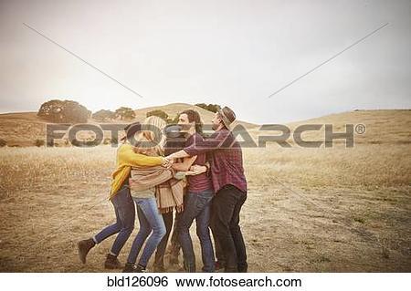 Stock Images of Friends hugging in rural landscape bld126096.