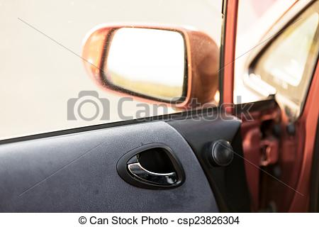 Stock Photography of Car door interior with rearview mirror.