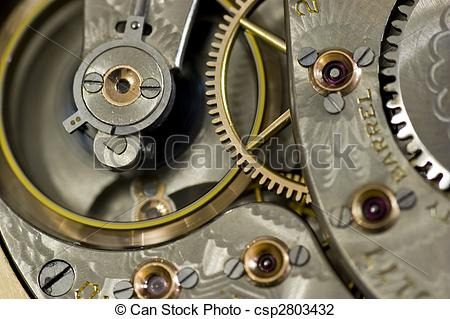 Stock Photo of Interior shot of old pocket watch with flywheel in.