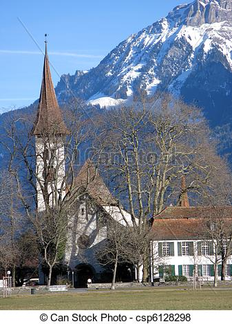 Pictures of View to an old church and mountains in Interlaken.
