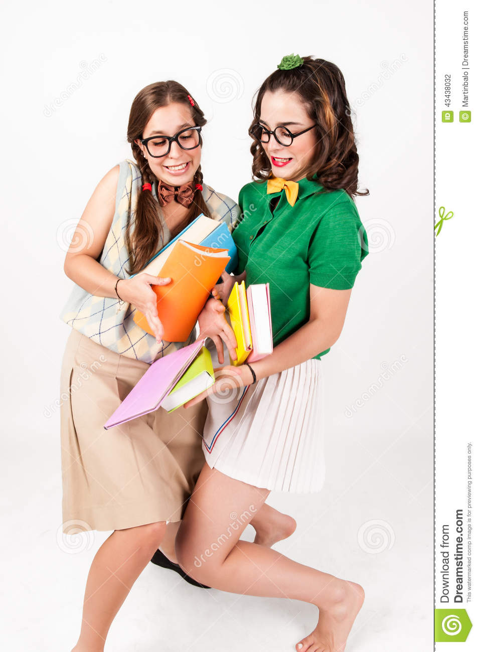 Cute Nerdy Girls Bump Into Each Other. Stock Photo.