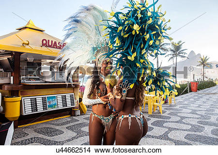 Stock Photo of Samba dancers drinking coconut drink, Ipanema Beach.