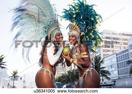 Stock Image of Samba dancers drinking coconut drink, Ipanema Beach.