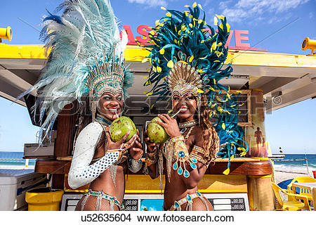 Stock Photo of Two samba dancers drinking coconut drinks, Ipanema.