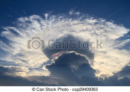 Stock Image of Iridescent pileus cloud or irisation clouds. The.
