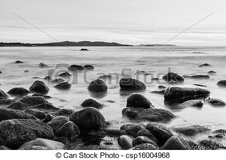 Stock Image of Rocks in the Irish Sea in black and white.