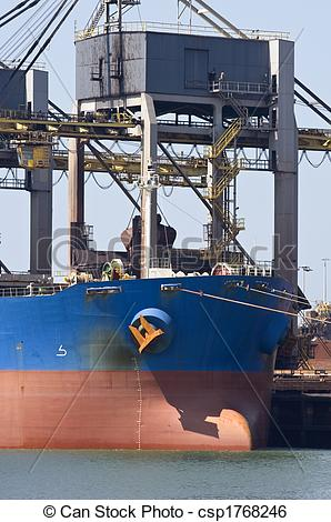 Stock Image of Unloading iron ore.