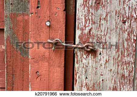 Stock Images of Cast Iron Hook and Eye Lock on Old Barn Door.