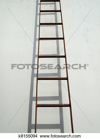 Stock Photo of Brown iron ladder on white wall k8155094.