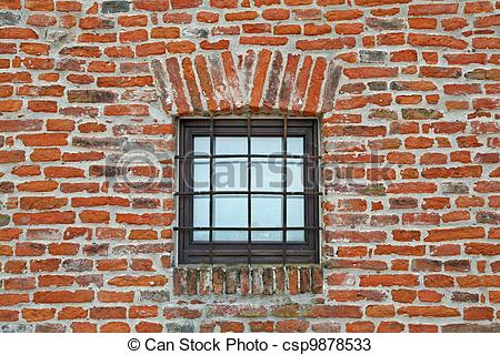 Stock Photos of brick wall with iron lattice window of an ancient.
