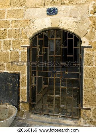 Stock Images of Rusty old iron lattice door k20550156.