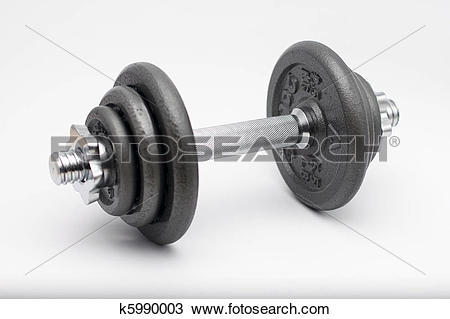 Stock Photo of Iron dumbbell with demountable weight plates on a.