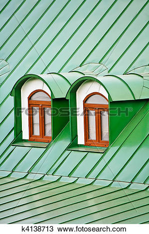 Stock Photo of Roof dormers on the roof covered with green iron.
