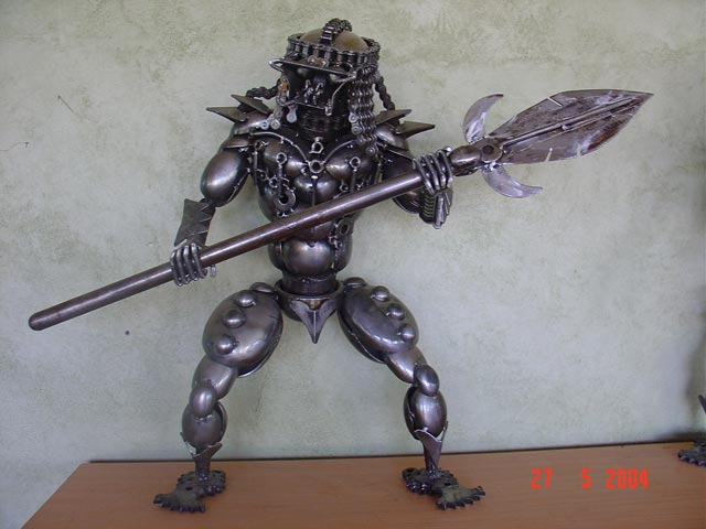 Predator ★ metal sculpture work of art made from old car parts.