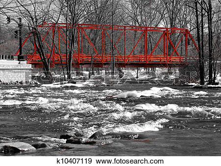 Stock Photograph of Wrought iron truss bridge, river view.