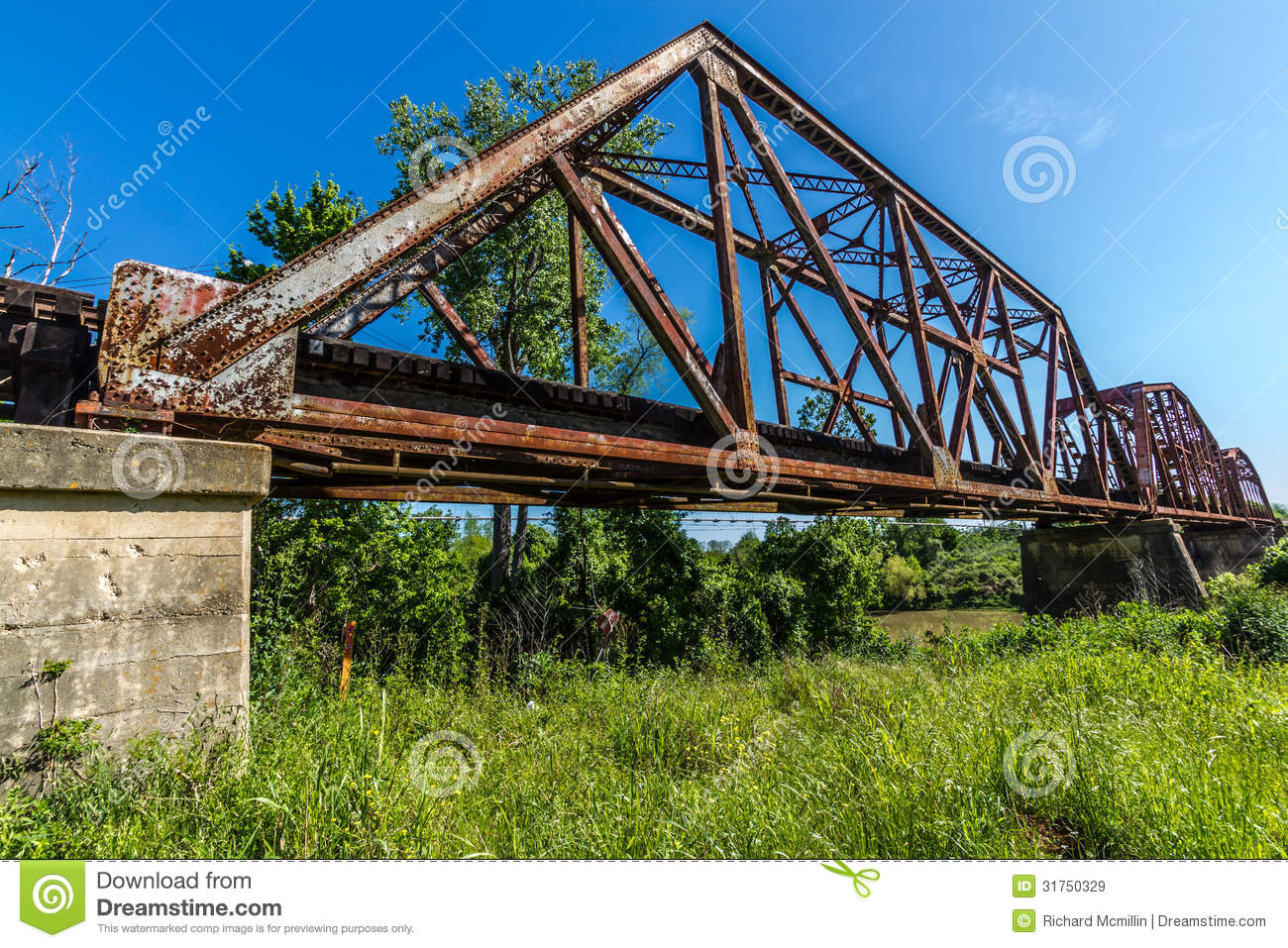 Angled View Of A Train Track And Closeup Of An Old Iconic Truss.