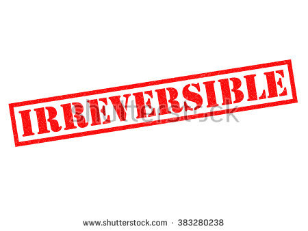 Irreversible Red Rubber Stamp Over A White Background. Stock Photo.