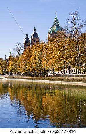 Stock Photography of Munich, Isar river and St. Luke church.