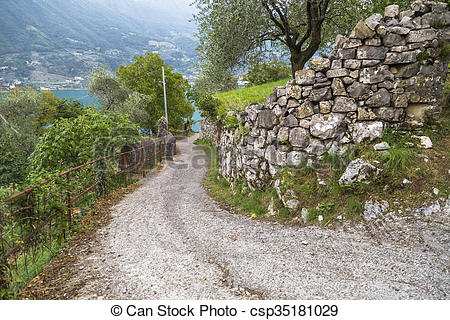 Stock Photo of Steep road from Lake Iseo in the mountains along a.