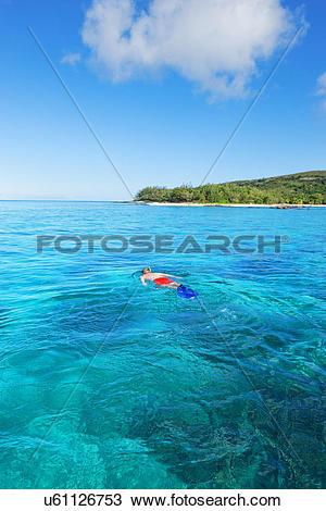 Stock Photo of Man snorkelling, Drawaqa Island, Yasawa island.