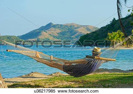 Stock Image of Man in a hammock, Yasawa Island Group, Fiji, South.