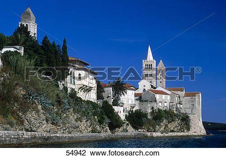 Stock Photo of Church on cliff against blue sky, Rab Island.
