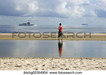 "Stock Photo of ""Woman on a beach, Heringsdorf, Usedom Island."