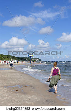 "Pictures of ""Woman walking on the beach, Bansin, Usedom Island."
