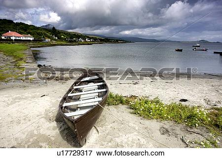 Picture of Islay, Scotland; An abandoned canoe by a beach.