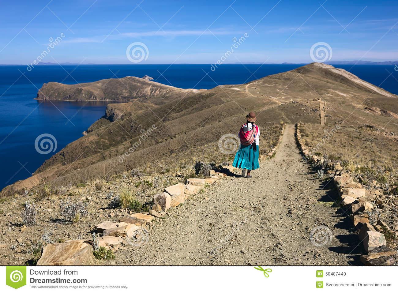 Woman On Path On Isla Del Sol In Lake Titicaca, Bolivia Editorial.