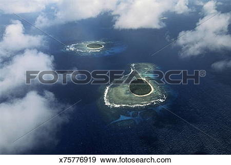 Stock Photograph of Coral islets, aerial view, Pacific Ocean.