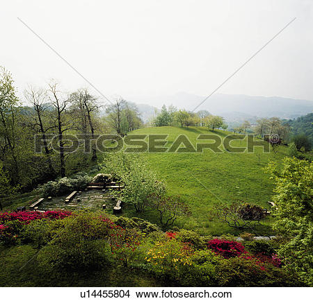 Stock Photo of View from large garden over grassy hilltop in.