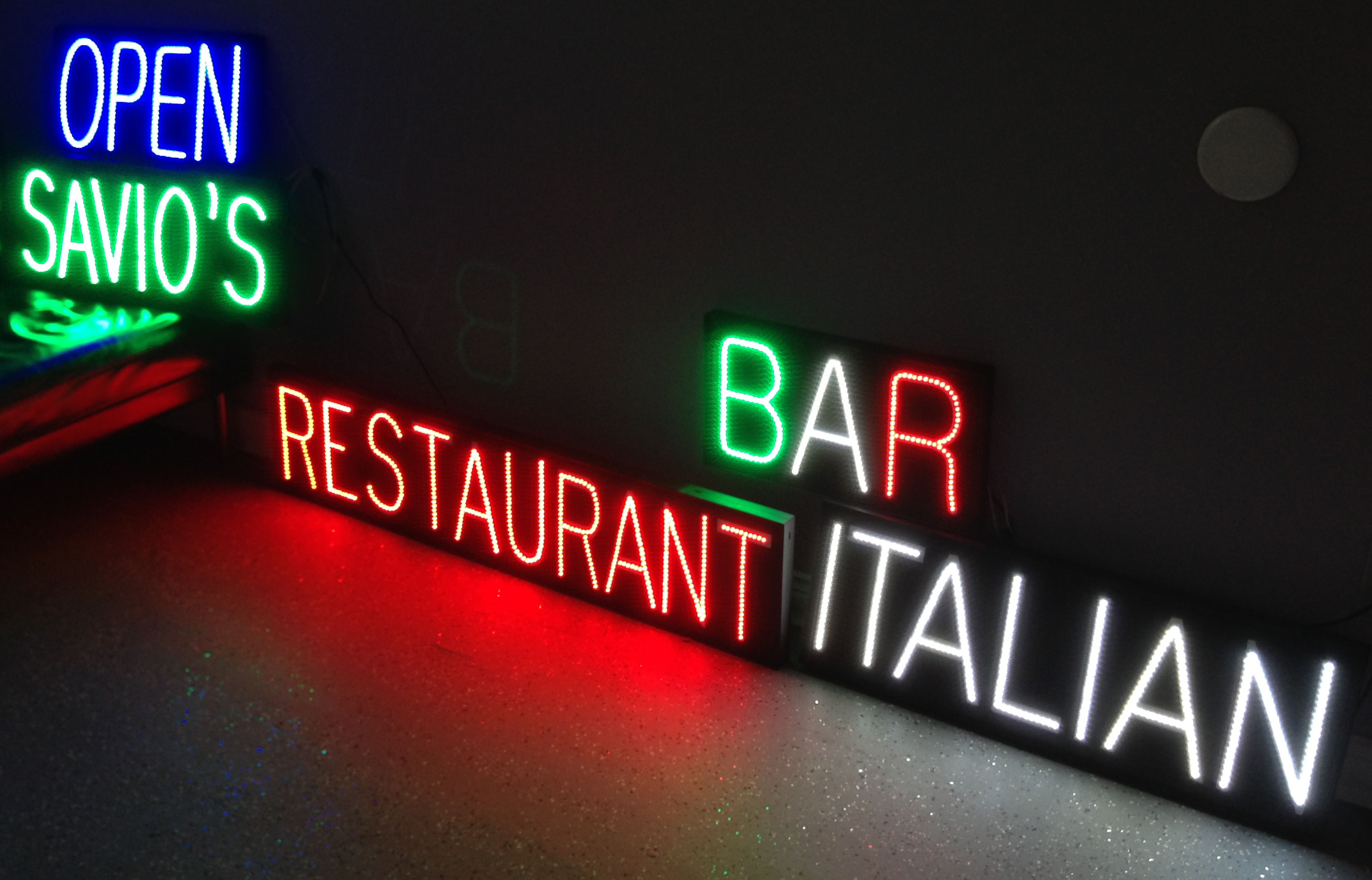 Custom LED signs for restaurant in Italian flag colors.