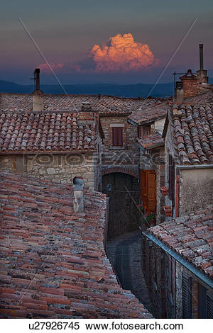 Stock Image of Rooftop view of Italian village street with houses.