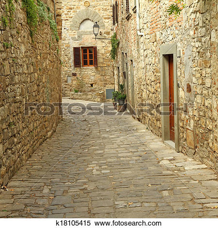 Stock Image of narrow paved street and stone walls in italian.