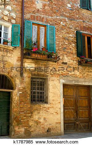 Stock Image of Turquoise shutter, Italian village k1787985.