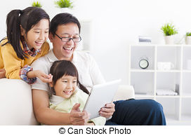 Stock Photography of happy little girl student touching tablet pc.