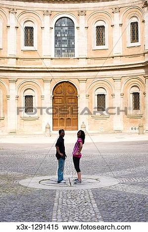 Stock Image of Couple standing in piazza St Ivo alla Sapienza Rome.