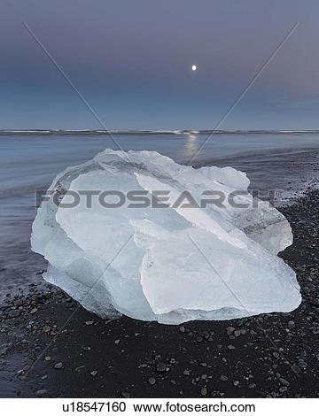 Stock Photography of Iceberg at Jokulsarlon beach, sunset with.