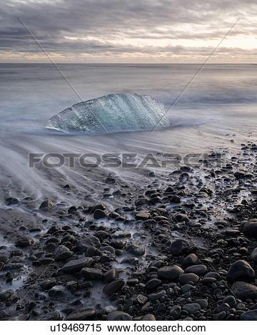 Stock Image of Iceberg on beach at sunset, Jokulsarlon, Iceland.